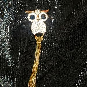 Owl brooch with blue eyes